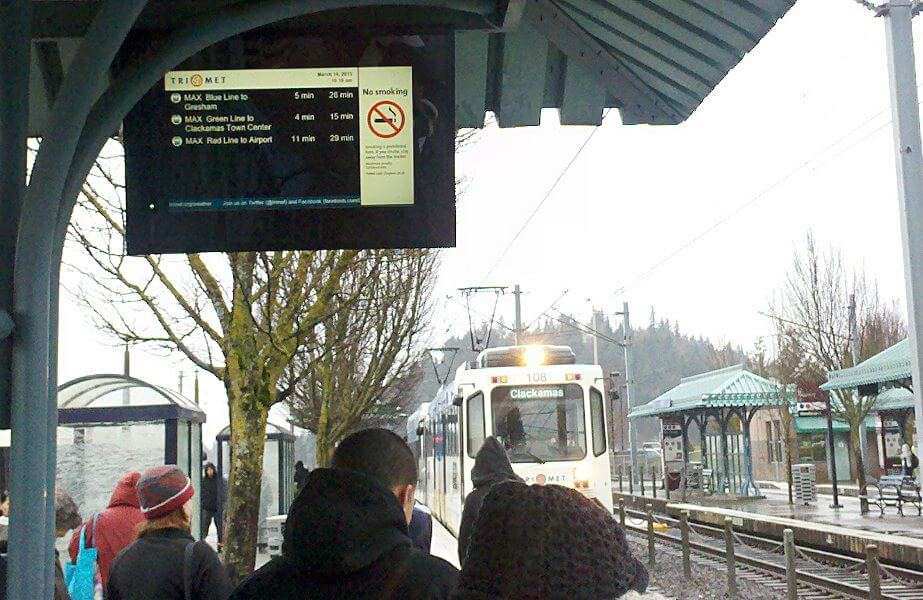 Bad timing! This train on the MAX arrived 4 minutes early (look at the LCD estimation sign and then back at the train).  When you have a train that's THIS reliable, you can expect a lot of people to be encouraged to be riding it. Right? Anyone?